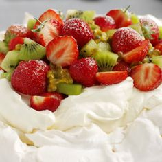 Strawberry and kiwi pavlova Make your very own strawberry and kiwi pavlova and impress your friends and family with this recipe. Bake your meringue the day before and then to serve top with whipped double cream, strawberries and Strawberry Kiwi, Strawberry Recipes, Kiwi Recipes, Gourmet Recipes, Dessert Recipes, Healthy Desserts, Greek Baklava, Traditional Christmas Food, Recipes