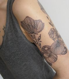 Poppies tattoo. I'm falling in love with outline-less tattoos, and only outlined tattoos.