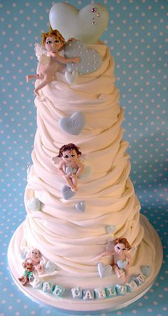 This is for a baby christening. But leave off the babies/fairies and it would be gorgeous with flowers for a wedding cake.