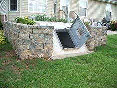 Underground storm/tornado shelter in landscaping - interiors-designed.com