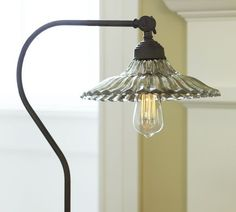 silvered glass shade for a vintage glow-- iron glass floor lamp