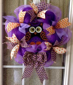 A personal favorite from my Etsy shop https://www.etsy.com/listing/475186655/fall-or-halloween-purple-deco-mesh