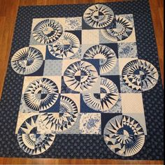 Found on Chris Jurd May 2016 blog - Natasha's quilt---New York Beauty variation -LOVE IT! This is really beautiful using all the blue and White fabrics!!