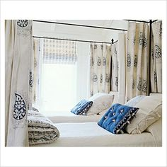 Could use curtains mounted via ceiling tracks to give a little privacy to beds.