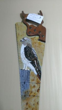 red tail hawk painted on a saw  Painting done by sam desgagnes