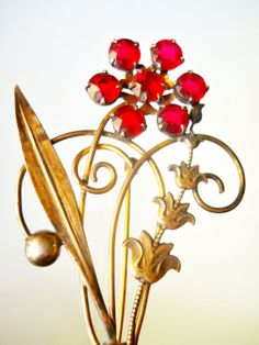 """12K Gold-Filled Brooch Art Deco Flower Vintage I.Michelson Red Rhinestone 1930s  I. Michelson (I. Michelson -- NY, NY -- 1884 until at least 1931, perhaps later) being presented by Renaissance Fair.   It is hallmarked 1/20th of 12K gold-filled (stamped) measuring a generous 3.5"""" x 1-5/8"""". The graceful swirling of stems with an arching leaf supports red rhinestones and prong-set flower"""