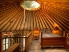 This eye-catching concept for a loft bedroom combines natural light with the warm colors of stained and natural wood furniture. www.blueridgeyurts.com