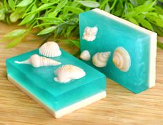 Bring the beach, clear turquoise water and sea shells into your home with these unique beach soaps. ❖ Description These glycerin soaps are handmade with white and clear soap bases. Theyre scented with Sea Moss, a lovely and ocean like scent. Its super fresh and clean! The green/blue layers are made with two colors and shimmer that make a wave effect. The tan layers have brown sugar added, which looks like sand and gives a mild scrub effect! The shells are glued on top with soap. The soap...