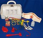doctor's kit!  OMG I totally forgot about this toy!!!  Now I'm remembering the plastic wigs and high heels with the straps of elastic!