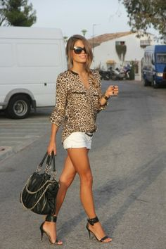 Follow the pic for more #Leopard print #blouse, #whiteshorts and #blackheels for ladies