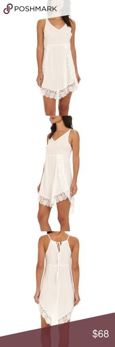 FREE PEOPLE eye lashes slip Soft and light weight slip dress. V-neckline & sleeveless construction. Seamed waist is figure flattering. Eyelash scalloped trim offers ultimate sexy appeal. Curved high-low hem-line. Alabaster colored. Free People Dresses High Low