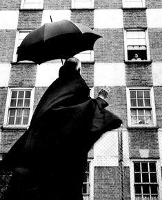 The Rev Reindorp greets a parishoner by Thurston Hopkins, London, 1954