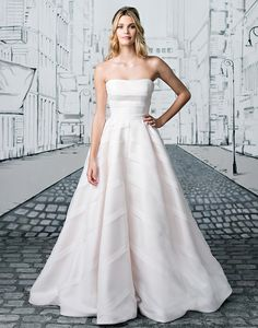 Justin Alexander wedding dresses style 8880 Allover geometric organza trim adorns this strapless ball gown with a cathedral length train creating a timeless wedding day look.