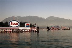 vancouver, bc, canada summer, 1972 floating service stations coal harbour part of an archival project, featuring the photographs of nick dewolf. Richmond Vancouver, Vancouver Bc Canada, Vancouver Island, West Coast Canada, Canada Summer, Old Pictures, Pacific Northwest, Historical Photos, Travel Posters