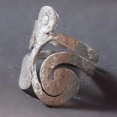 Spirals exist everywhere in nature! New photos for my handmade spiral long ring! ...
