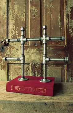 Industrial chic jewlery display stand -large.  Mounted to a stack of books  LOVE (readers digests would look great)