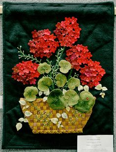 """""""Baskets of Geraniums"""" by Natalie J. Brobst, of Mentor is on display at Quilts 2014 at Lake Metroparks Farmpark. Photo by Jeff Forman for The News-Herald. For more information about Quilts 2014 visit http://lakemetroparks.com/programs/quilts2014"""