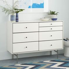Storage Furniture - Lofted on a graceful, brushed metal base, the Heston Mid-Century Dresser is crafted with inset drawers that expose contrast black reveals.