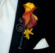 The coil makes it a little too Tim Burton for me, but I like the calla lilly and kangaroo paw~~