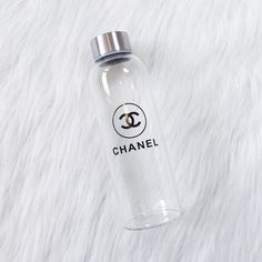 """clear glass Chanel water bottle •size: About 8"""" tall  •features: clear glass Chanel water bottle with a silver cap. comes with a black case (shown in last picture)  •new never used  •no trades   price is pretty FIRM  ❗️ all sales are FINAL CHANEL Accessories"""