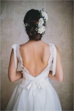 The way there are little ribbon bows on both shoulders. | 50 Gorgeous Wedding Dress Details That Are Utterly To Die For