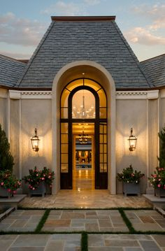 .Beautiful front entry, what great curb appeal with beautiful lighting that sets a elegant tone to this place.