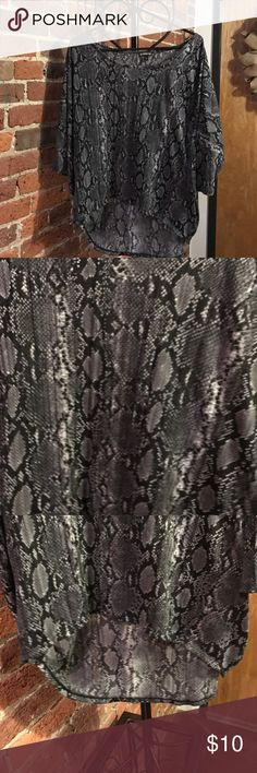 Express snakeskin shirt This gently worn shirt has a cute snake skin pattern, high low bottom, and fits a little bigger than the size. 🐍 Make reasonable offer. Express Tops Blouses
