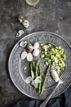 Asparagus salad with quails eggs, broad beans and cucumber shot for Caldesi Venice Cookbook. Prop styling by Linda Berlin.