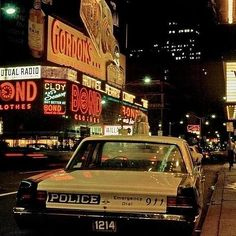 Times Square New York City, 1971, with vintage NYPD squad car, in white, green and black. Love the massive light on top!