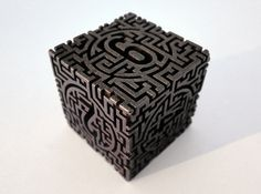 Labyrinthine Die6 3d printed In polished bronze steel