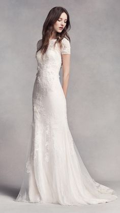 Simple off-white gown with embroidery and sleeves
