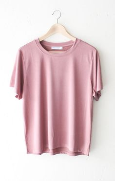 "- Description Details: Soft & relaxed basic tee in vintage rose. Relaxed fit. Measurements (Size Guide): S: 44"" waist, 23.5"" length M: 46"" waist, 24.0"" length L: 48"" waist, 24.5"" length 64% Modal, 36%"