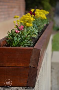 Add curb appeal to your home by placing this DIY planter on your front porch with some of your favorite summer flowers. It's a great weekend project that will brighten your whole front yard.