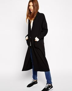 This season, the popular duster coats are still a big ''YES''. Wear them over your sweater or just over a shirt or simple blouse for everyday. Find it here: http://asos.to/1AWTN9u