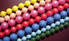 Plastic beads that snapped together were a real fad nthe 1960's...they were called pop beads...you could make them any length you wanted.