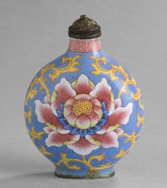 An eighteenth-century Chinese snuff bottle, copper decorated with enamel colours; its central motif is a lotus, symbol of purity. (Philadelphia Museum of Art)