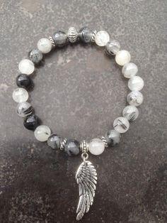 Bracelet en quartz rutile et sa médaille aile d'ange