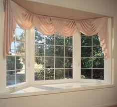 Bay windows are a spectacular sight. From the outside, they are ornamental, decorating the exterior of the home with a three-dimensional frame. And from the inside, the windows provide a small bay -- the perfect nook for sunrise reading or sipping at tea. #Bay #Window #Curtains Small Basement Remodel, Basement Remodeling, Basement Plans, Basement Storage, Kitchen Remodel, Basement Workshop, Basement Decorating, Bedroom Remodeling, Basement Makeover