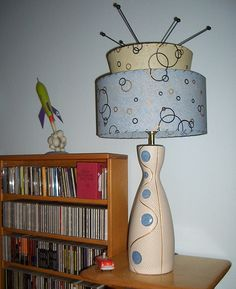 """Vintage lamp with """"sputnik"""" ornament on top finial and new two-tier shade from moonshineshades.com."""
