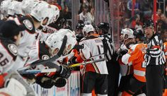 Francis Charron #6 gestures towards the Anaheim Ducks bench during a second period scrum with the Philadelphia Flyers