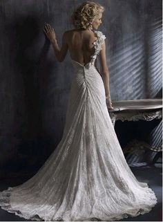 Lace wedding dress with floral detail on one strap - the rouching which gathers on the lower back is stunning