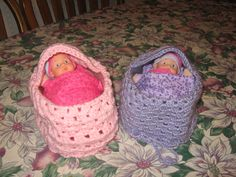 Doll bassinets/purses with bedding - made for my grandnieces for Christmas 2011. Dolls in their bassinets.