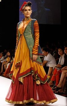 Here's a look at designer Shruti Sancheti's latest line, showcased on the third day of Lakme Fashion Week. Indian Bridal Wear, Indian Wedding Outfits, Indian Outfits, Frock Fashion, Fashion Dresses, Indian Designer Outfits, Designer Dresses, Choli Blouse Design, Saree Wearing Styles