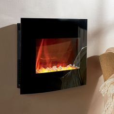 2-in-1 Wall Electric Fireplace ($200) ❤ liked on Polyvore featuring home, home decor, fireplace accessories, electric fireplace, wallmount electric fireplace, black home decor and fireplace space heater