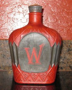 Here's the 2nd painted Crown Royal bottle finished.  (idea stolen from http://www.turnstylevogue.com/2012/02/glass-bottle-makeover.html)  Painted with Annie Sloan Chalk Paint Emperor's Silk and Graphite.