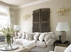 Slipcovered super comfy sofa and old reclaimed Mexican shutters used as interior design accent