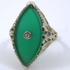 Vintage Marquise Cut Green Onyx Ring with Round Cut Diamond Accent. Set in 14K Yellow Gold.  - $1350