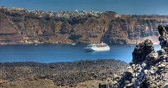 Thira hanging from the clifs and Volcano rocks , Santorini Island , Greece