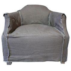 "A sophisticated-cool Verellen Magalie Club Chair in metal gray rustic linen with contrasting inside out stitching in white.  The slipcovered style gives the piece a relaxed look. The piece features signature Verellen quality and style.   Seat height 20"". Two available, priced and sold individually. Please contact support@chairish.com to purchase the pair.   Have you ever fallen head-over-heels in love with a piece of upholstery? That's the sort of cupid's-arrow experience Verellen offers…"