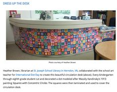 Library Circulation Desk decorated with student artwork